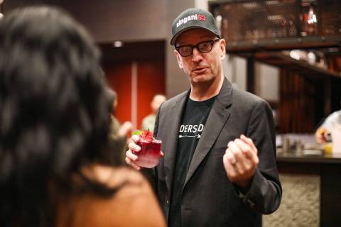 Oscar-winning director Steven Soderbergh talks with a local bartender while promoting the liquo ...