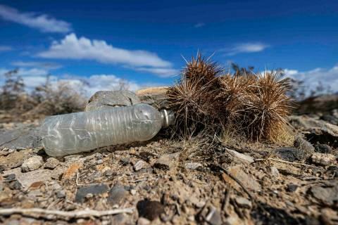 An empty water bottle in a vacant field on Saturday, Oct. 9, 2021, in Las Vegas. (Benjamin Hage ...