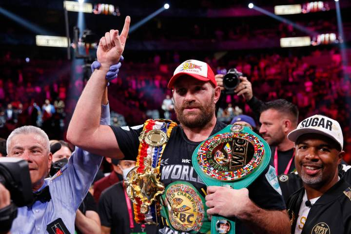 Tyson Fury, of England, celebrates after defeating Deontay Wilder in a heavyweight championship ...