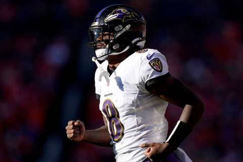 Baltimore Ravens quarterback Lamar Jackson (8) takes the field during the second half of an NFL ...