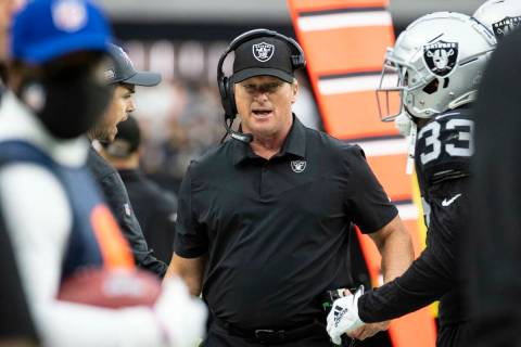Raiders head coach Jon Gruden walks on the side line during the first half of an NFL football g ...