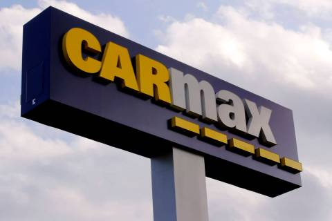 A sign at the CarMax dealership in Manchester, N.H., Thursday, Aug. 15, 2019. (AP Photo/Charles ...