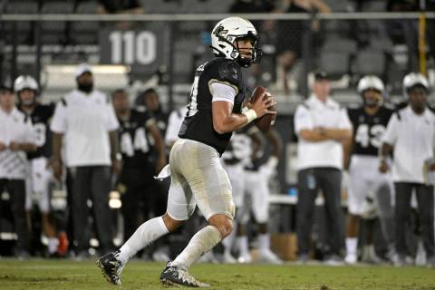 Central Florida quarterback Dillon Gabriel (11) sets up to throw a pass during the second half ...