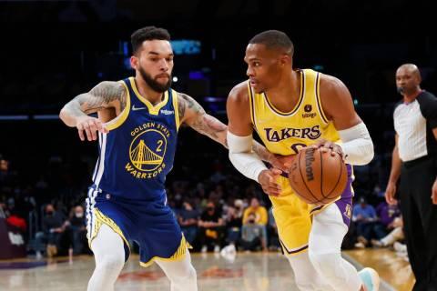 Los Angeles Lakers guard Russell Westbrook (0) drives against Golden State Warriors forward Chr ...