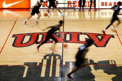 UNLV players participate in drills during an open basketball practice and fundraiser for former ...