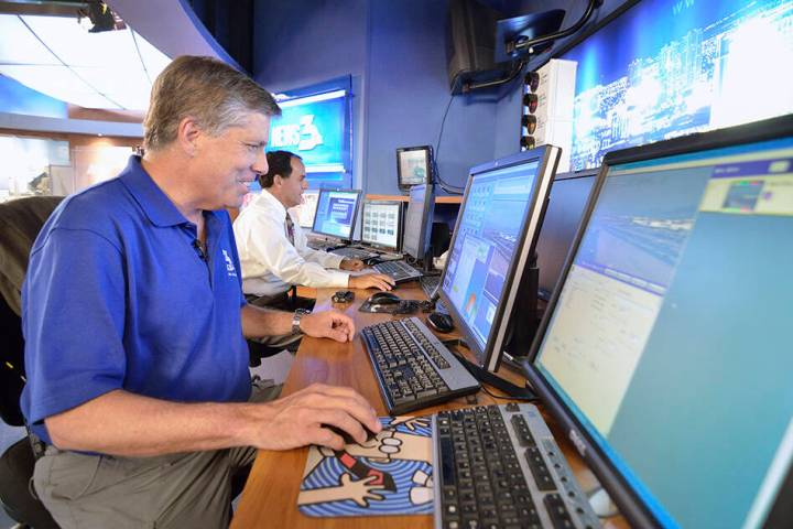 Tom Hawley prepares for the evening newscast at KSNV-TV with Chief Meteorologist Kevin Janison ...