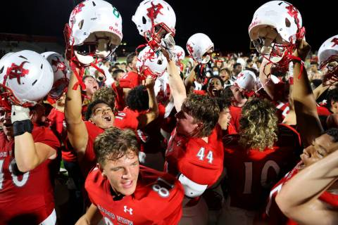 Arbor View players celebrate a 22-21 win over Desert Pines during a football game at Arbor View ...