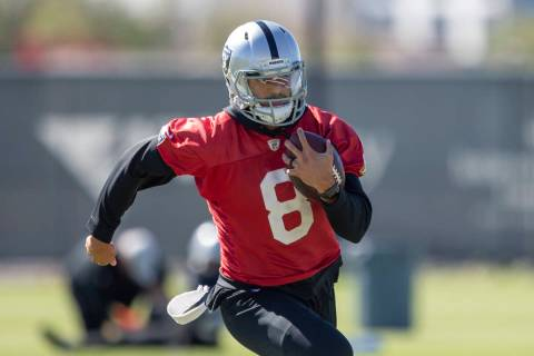 Raiders quarterback Marcus Mariota (8) runs with the football during a practice session at the ...