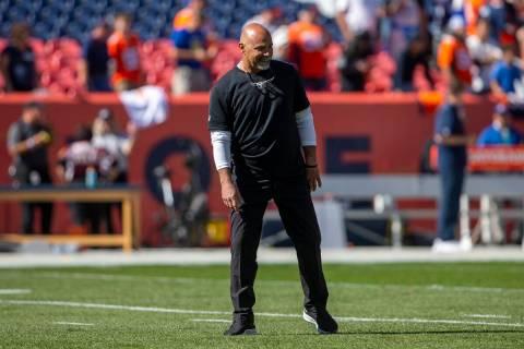 Raiders interim head coach Rich Bisaccia takes the field for warm ups before an NFL football ga ...