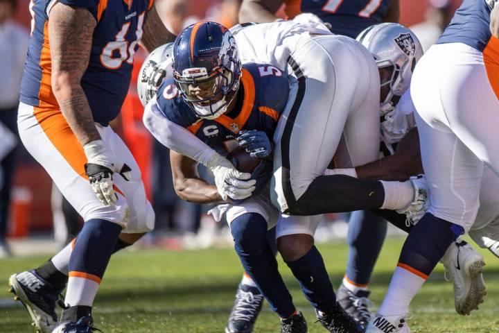 Denver Broncos quarterback Teddy Bridgewater (5) is sacked by Raiders' defensive end Maxx Crosb ...