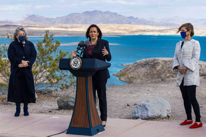 Vice President Kamala Harris speaks as Congresswoman Dina Titus, left, and Representative Susie ...