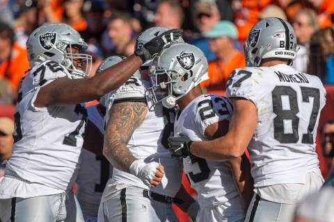 Raiders guard John Simpson (76), Raiders center Andre James (68) and Raiders tight end Foster M ...
