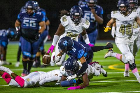 Canyon SpringsÕ Lackawanna Caston (12) fumbles the ball after a hard hit by FoothillÕ ...