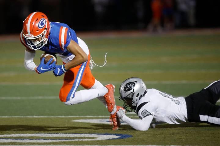 Bishop Gorman High School's Audric Harris (17) carries a ball as Palo Verde High School's Dupar ...