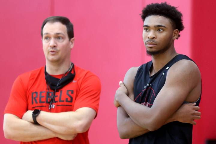 UNLV coach Kevin Kruger with guard Bryce Hamilton after practice at the Mendenhall Center in La ...