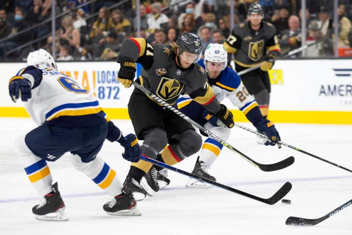 Golden Knights center William Karlsson (71) breaks for the net defended by Blues defenseman Mar ...