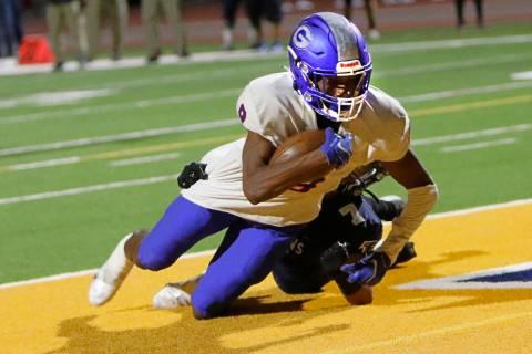 Bishop Gorman High School's Maleik Pabon (8) scores a touchdown over Foothill High School's Kel ...