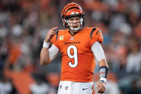 Cincinnati Bengals quarterback Joe Burrow (9) walks to the sidelines during an NFL football gam ...