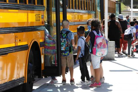 John S. Park Elementary School students leave the school after their class in Las Vegas, Wednes ...