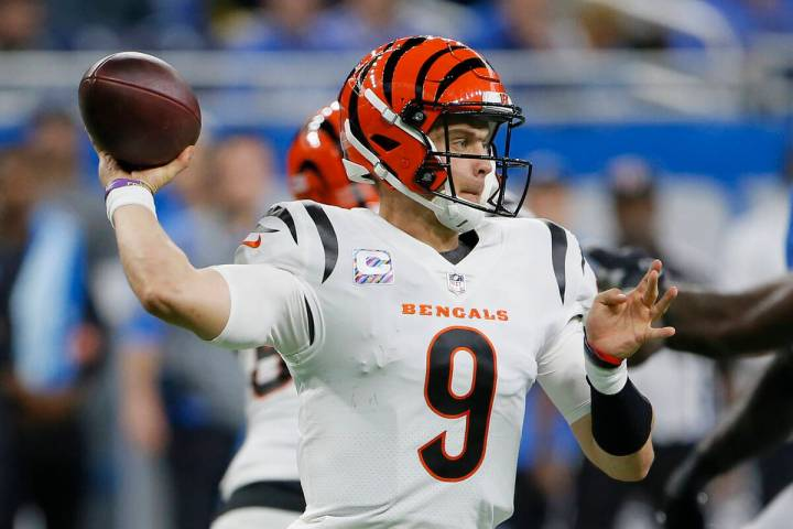 Cincinnati Bengals quarterback Joe Burrow (9) passes the ball during the first half of an NFL f ...